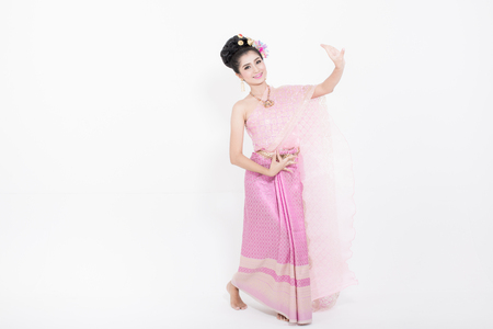Woman wearing thai dress and performing typical thai dance, identity culture of Thailand.