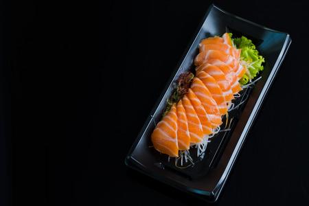 Salmon Sashimi on Black Ceramic Plat,black background. Stockfoto