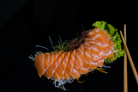 Salmon Sashimi on Black Ceramic Plat,black background. 版權商用圖片
