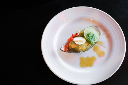 Mussel toping galic and lemon, fusion food Stock Photo