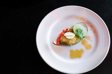 Mussel toping galic and lemon, fusion food Stock fotó