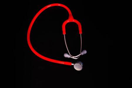Red Stethoscope on black background