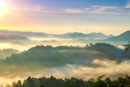 Beautiful Landscape of mountain layer in morning sun ray and winter fog. Stock fotó