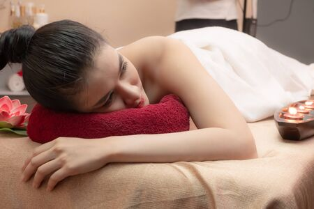 Beauty Woman Relaxing and Lying Down in spa salon.