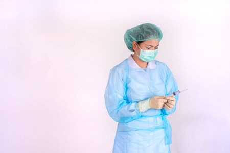 Hand of a nurse with a syringe on white background