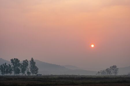he sun is rising in the morning in the north of Thailand.