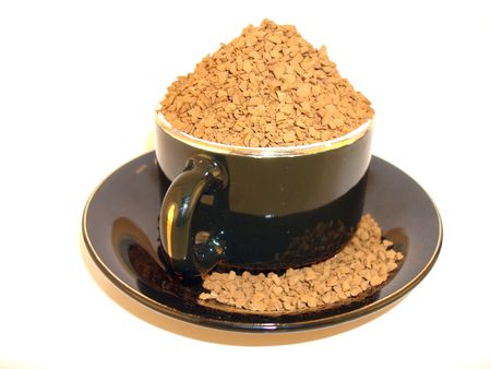 Coffee Cup overflowing with coffee granules Stock Photo - 599000