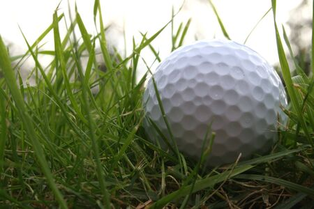 Golf ball in the rough from a low below ground angle Stock Photo - 628380