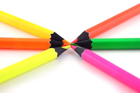 Neon pencils pointing at each other on a white background Banco de Imagens - 670299