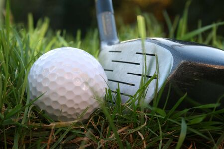 Driver about to hit a golf ball from the rough - low angle shot  Banco de Imagens