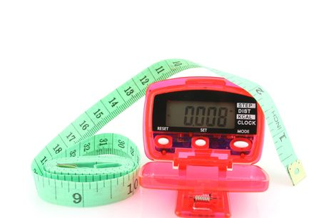 Close up of a Pedometer and tape measure - isolated on a white background Banco de Imagens - 761289