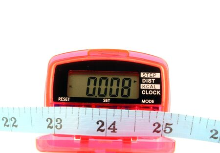 Close up of a Pedometer and tape measure - isolated on a white background Imagens - 798514