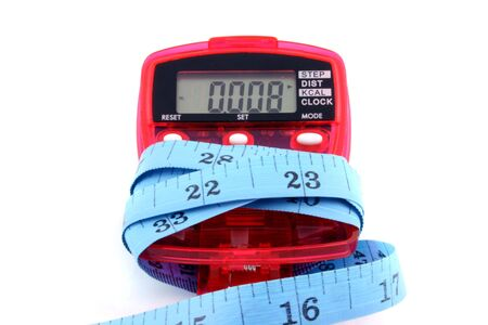 Close up of a Pedometer and tape measure - isolated on a white background Imagens - 798527