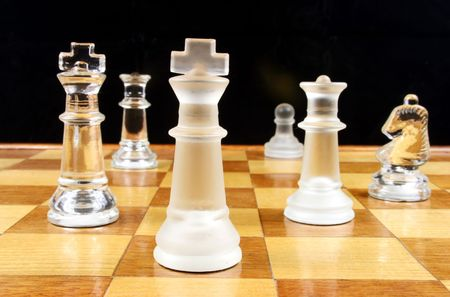 End Game - Glass Chess Pieces on a wooden chessboard Banco de Imagens - 819445