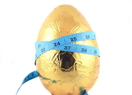 Close up of an easter egg with tape measure  Banco de Imagens