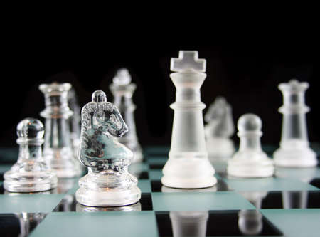 Glass Chess Pieces on a Frosted Glass Chess Board Banco de Imagens - 872604