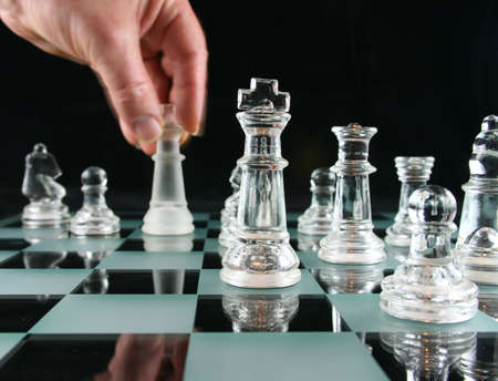 strategize: The Last Move in Chess with Motion Blur on hand