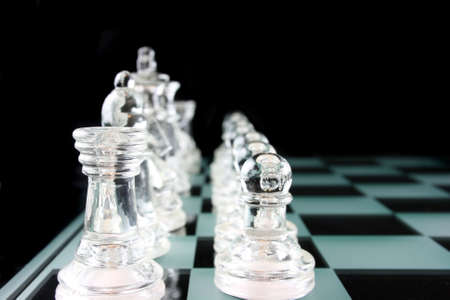 Glass Chess Pieces on a Frosted Glass Chess Board   Banco de Imagens