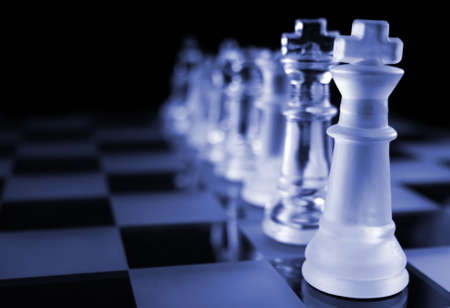 strategize: Glass Chess Pieces on a Frosted Glass Chess Board Stock Photo