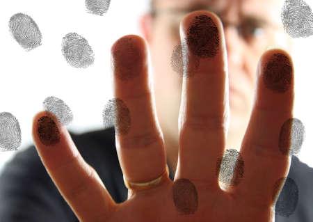 Man leaving fingerprints on glass