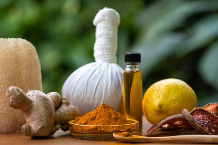 Natural medicine herb close-up.Healthcare spa ingredient such as lemon ginger tumeric massage oil organic aroma.Alternative medicine.