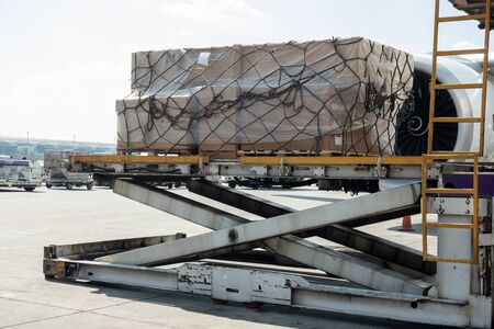 Air cargo logistic containers are loading to an airplane.Transportation and aerospace industry deliver luggages of passenger when aircraft arrive at the airport. Reklamní fotografie
