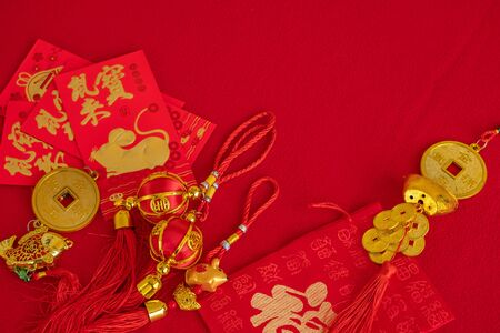 Chinese new year with golden mouse to celebrate of china people.Red background carpet and copyspace is available.