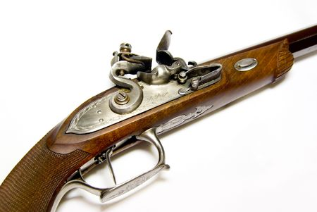 Antique handgun on a white background