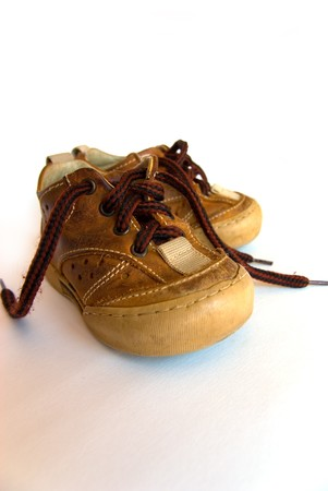 and worn out: Worn out child shoes.