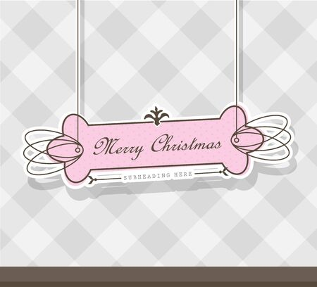 clothing label: Pink Christmas label on gray background.