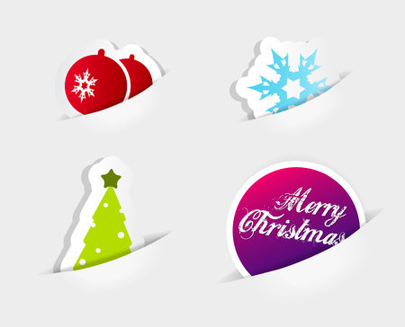 outs: Four icons symbolizing Christmas slipped in to paper cut outs.