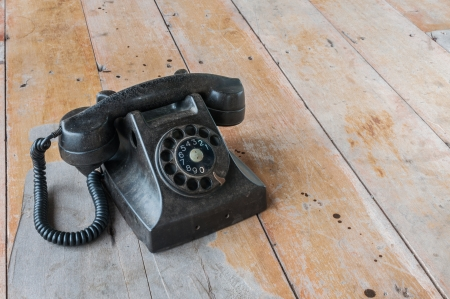 Old telephone with wood background