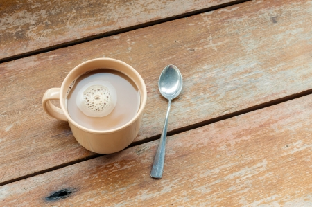 A cup of coffee with wood background Stock Photo