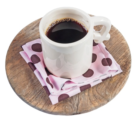 A white cup of coffee on pink napkin on the wood isolated white backgroud