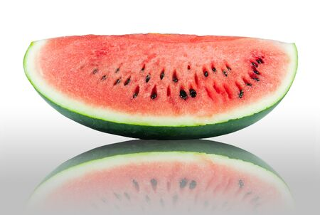 Slice of watermelon with reflection on the white background