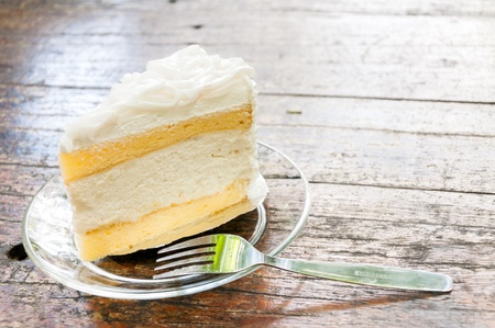 a piece of coconut cake with a fork  Stock Photo
