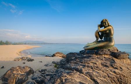 Ole mermaid statues on the beach. Landmark of samila beach, Thailand.
