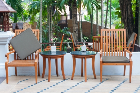 a wooden table set in  garden setting