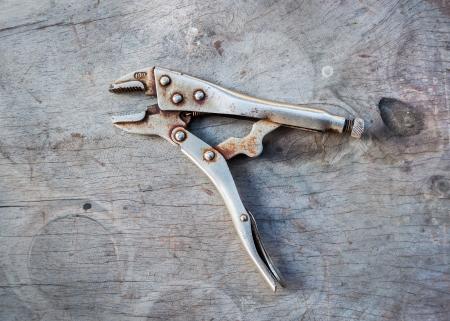 plier: Old Lock Grip Pliers on wood, HDR effect