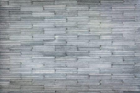 Modern gray slate Stone Wall - Background Texture Stock Photo