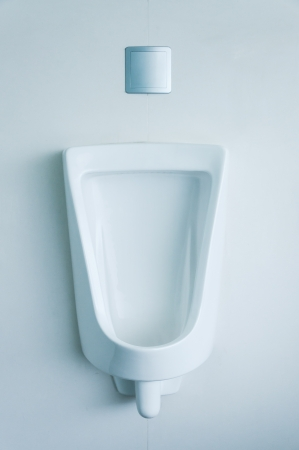 white porcelain urinal in public toilets