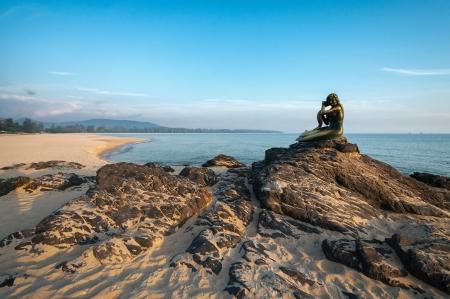 Ole mermaid statues on the beach  Landmark of Samila beach, Thailand