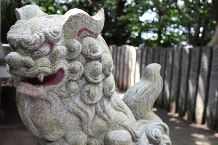 shinto: At the guardian liondog at Shinto shrine Stock Photo