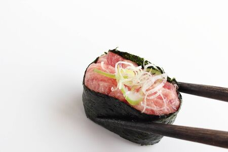 price cutting: Sushi with chopstick Stock Photo