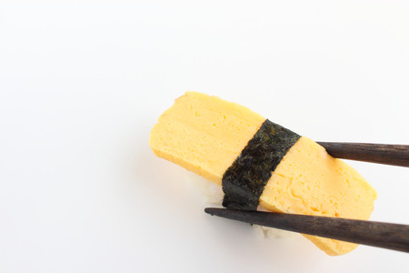 Sushi in chopsticks Stock Photo