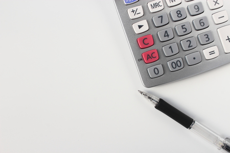 simple background: Calculator and pen Stock Photo
