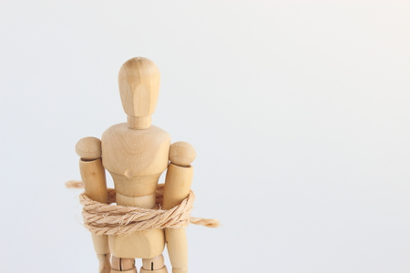 being arrested: Wooden man toy Stock Photo