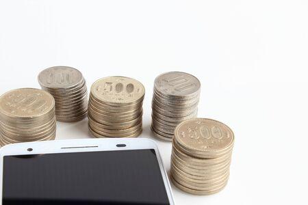 smart phone and money Stock fotó