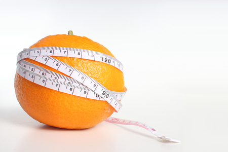 Mandarin orange and measure Stock Photo