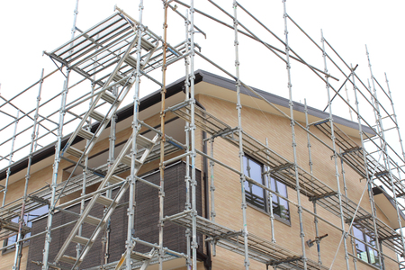 Scaffolding of new housing construction Stock Photo